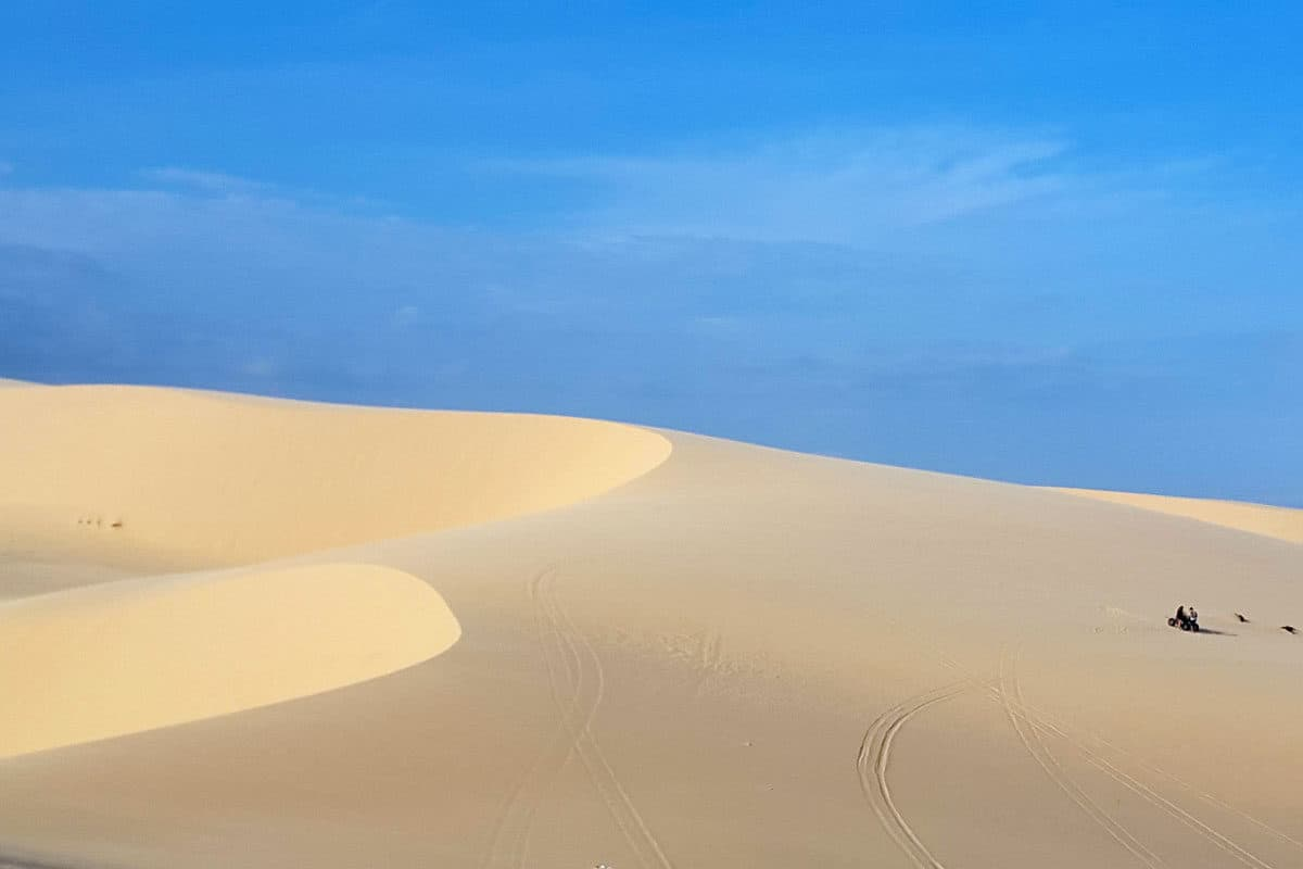 The white sand dunes of Mui ne against a blue sky. One of the most popular things to do in Mui Ne