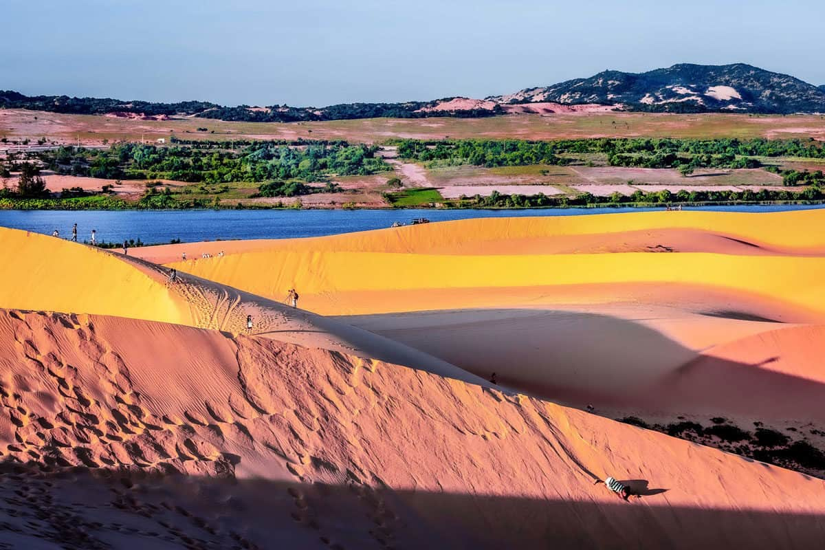 The red sand dunes of Mui Ne in Vietnam. Sandboarding on the dunes is one of the most popular things to do in Mui Ne