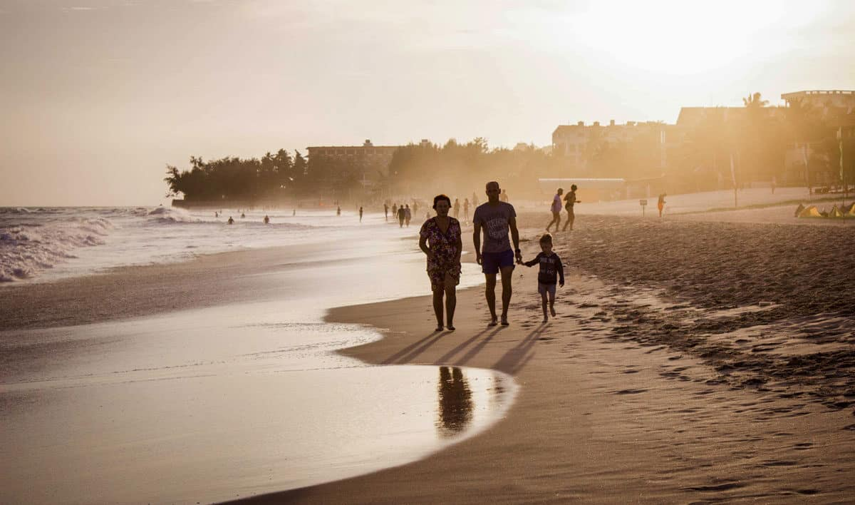 Family walking along the beach at sunset in Mui Ne Vietnam