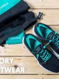 A flat lay shot of a black and green pair of Tropicfeel travel shoes. Are these the best travel shoes?