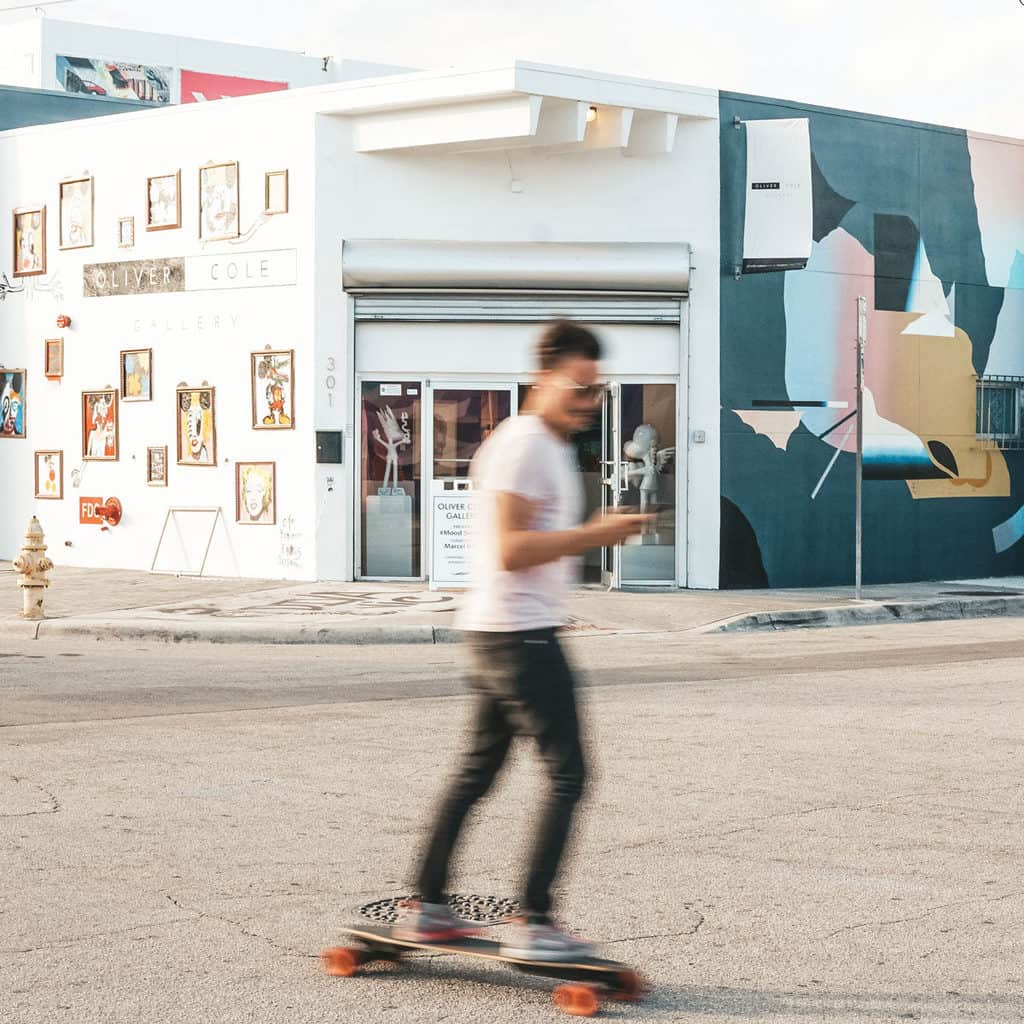 Skateboarding around the Wynwood mural district.