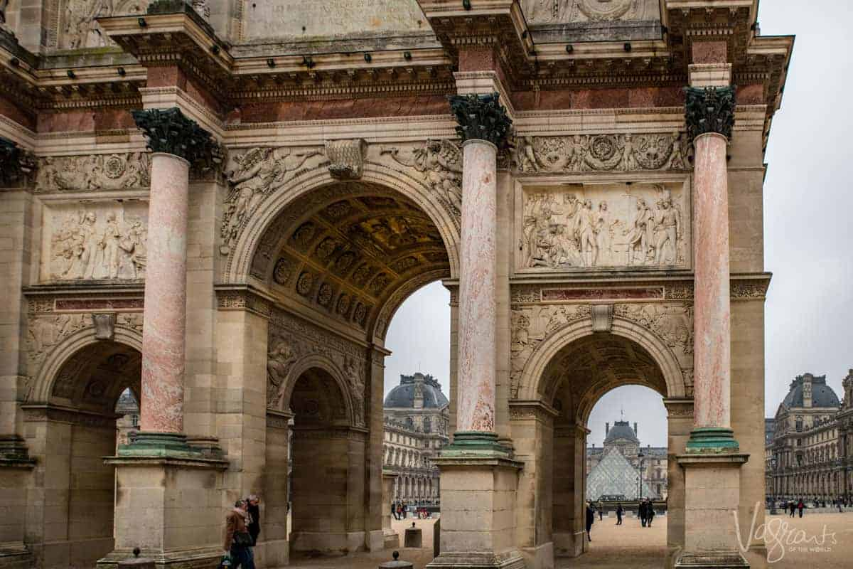 Looking through the The Arc de Triomphe du Carrousel to the Louvre Pyramid. Paris is the first stop on the Paris to the Swiss Alps cruise. A wonderful start to seeing Europe's best Christmas Markets.