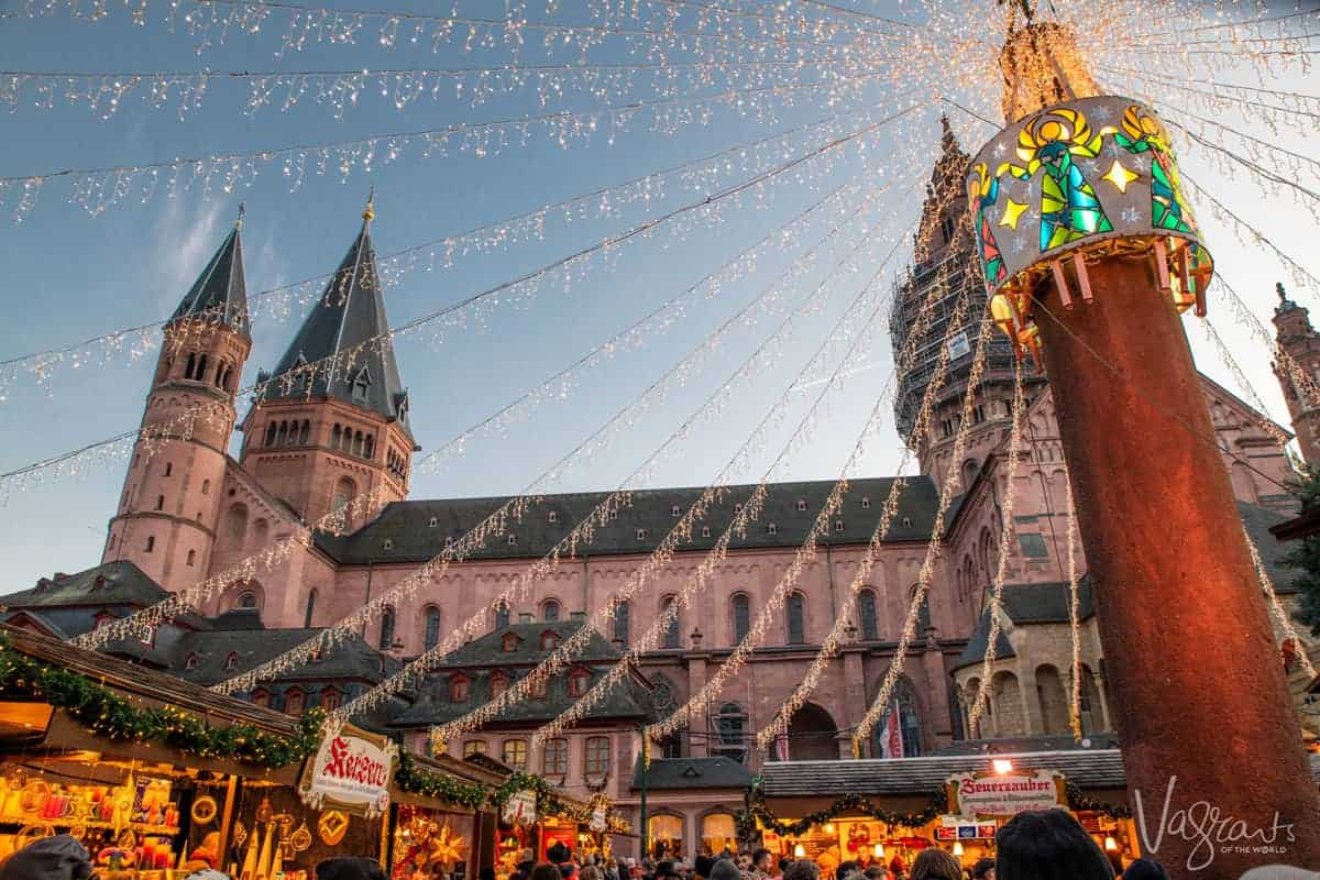 Looking up at the Mainz cathedral with the Christmas markets in the foreground. One of tht stops on the Paris to Swiss Alps cruise with Viking Cruises