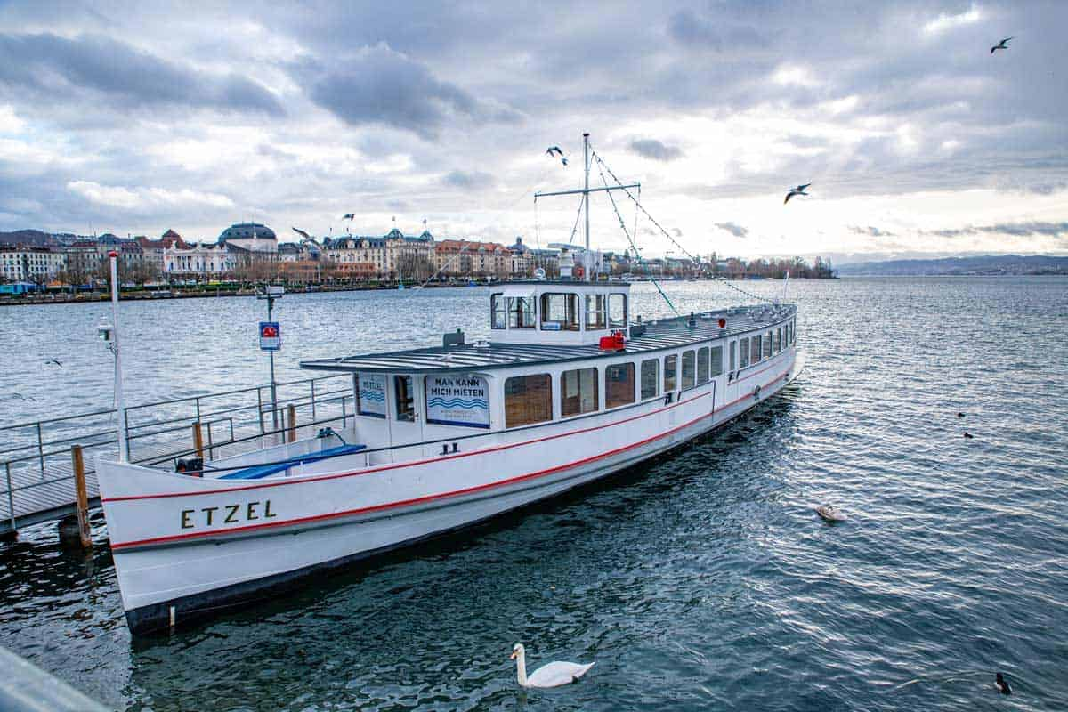 Old fashioned ferry boat on the shores of Lake Zurich, a lake cruise is a great way to spend your time.