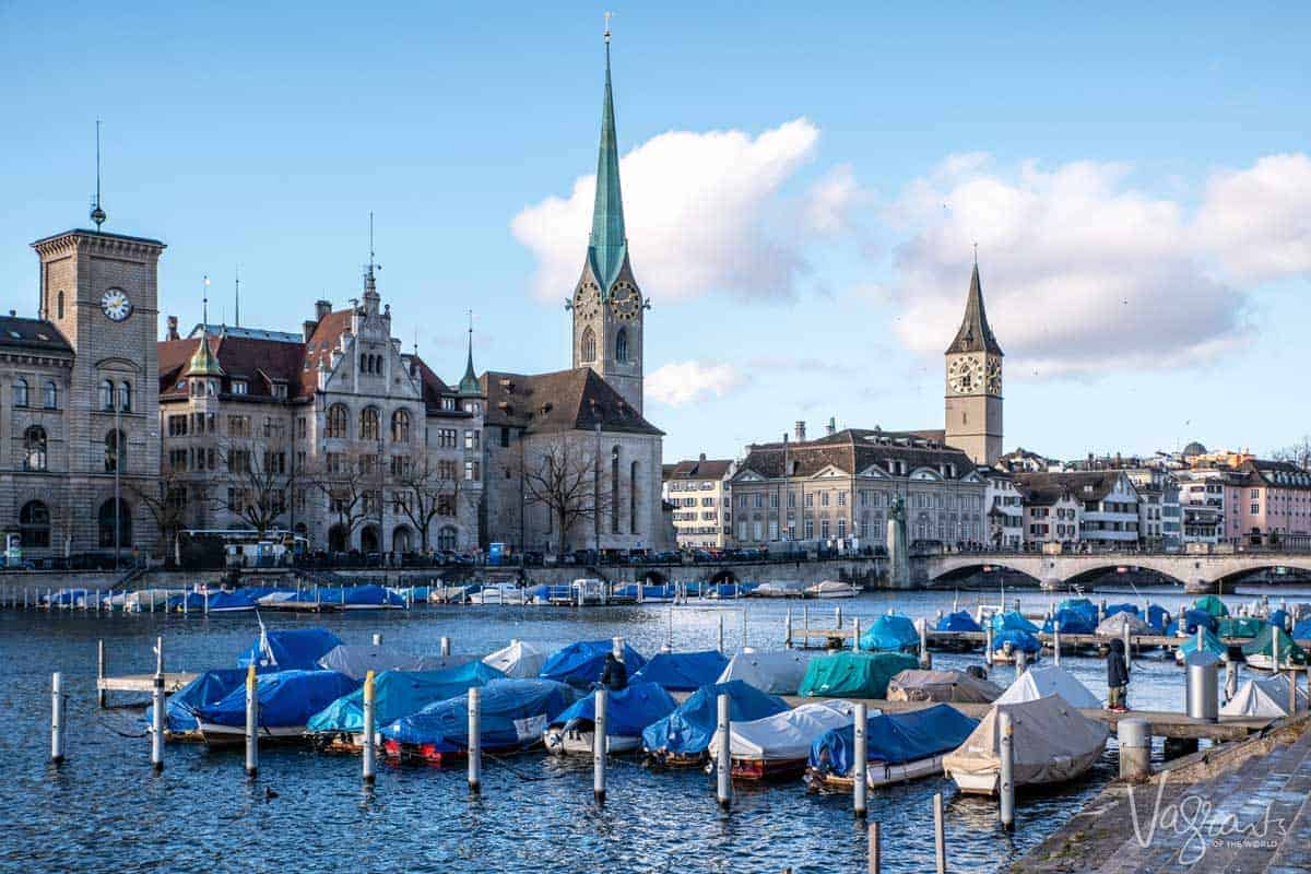 River boats moored and Zurich Old town with the church spires.