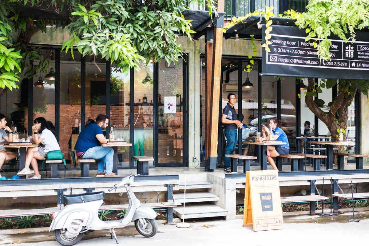 People sitting outside at Ristr8to cafe in Coffee Street in Chiang Mai