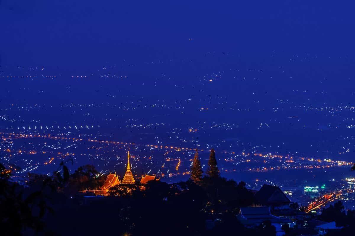 Night lights of chiang Mai with Wat Phra That Doi Suthep temple lit.