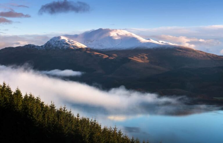 View of Ben Lomond Mountain Scotland with cloud shrouding the top of the mountain when hiking in Scotland