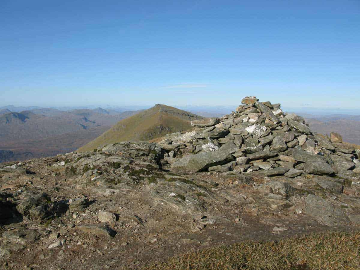 Hiking trail Stob Binnein Summit Cairn north towards Ben More, Scotland.
