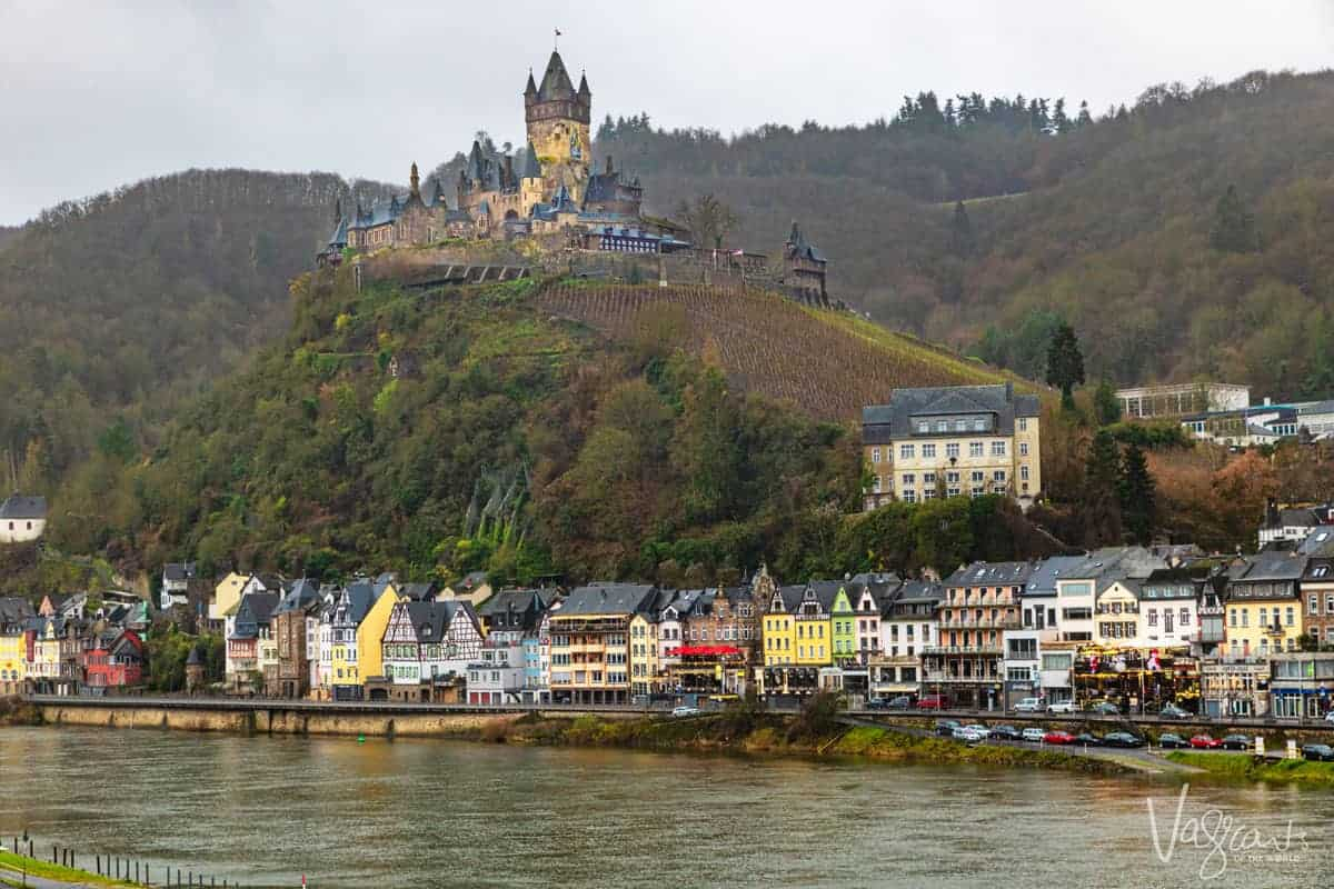 Reichsburg Castle perched above the coloured houses that line the Moselle River in Cochem Germany. One of the stops on the Paris to Swiss Alps River Cruise.