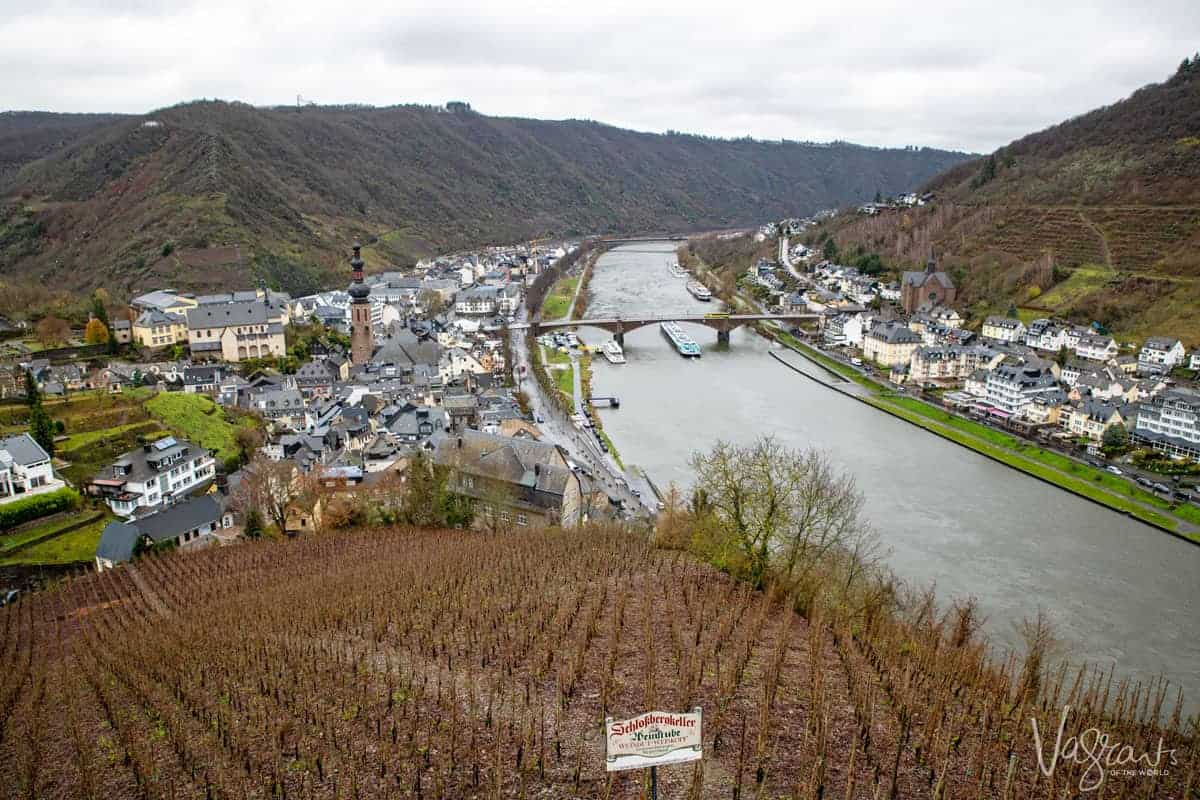 Aview down the Moselle River from above at Reichsburg Castle with winter vineyard scene on the foreground.