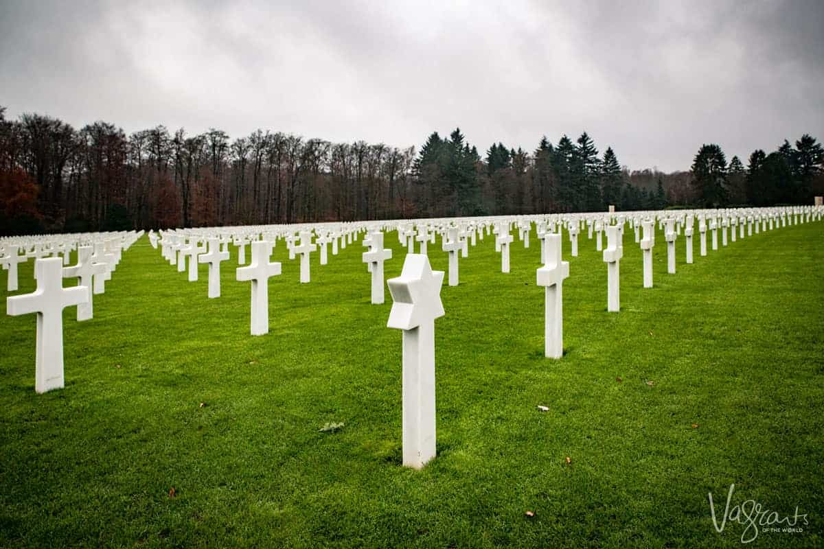 Looking over all the crosses on the bright green grass at the Luxembourg American Cemetery