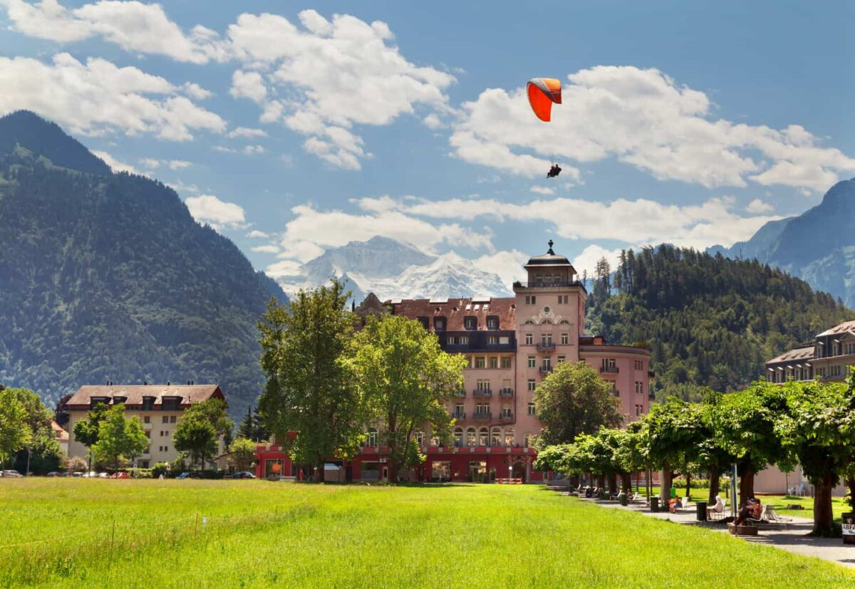 Para glider against mountains and hotel in Interlaken, Switzerland