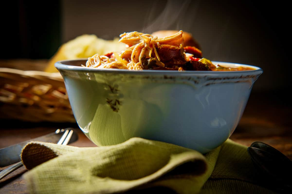 A close up of a steam bowl of gumbo