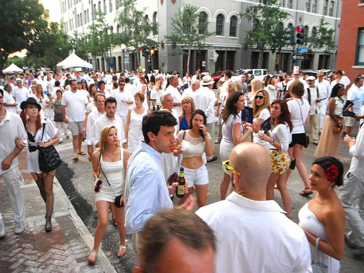 A crowd of people gathered in the streets of New Orleans dressed in White for the White Linen Night fetsival