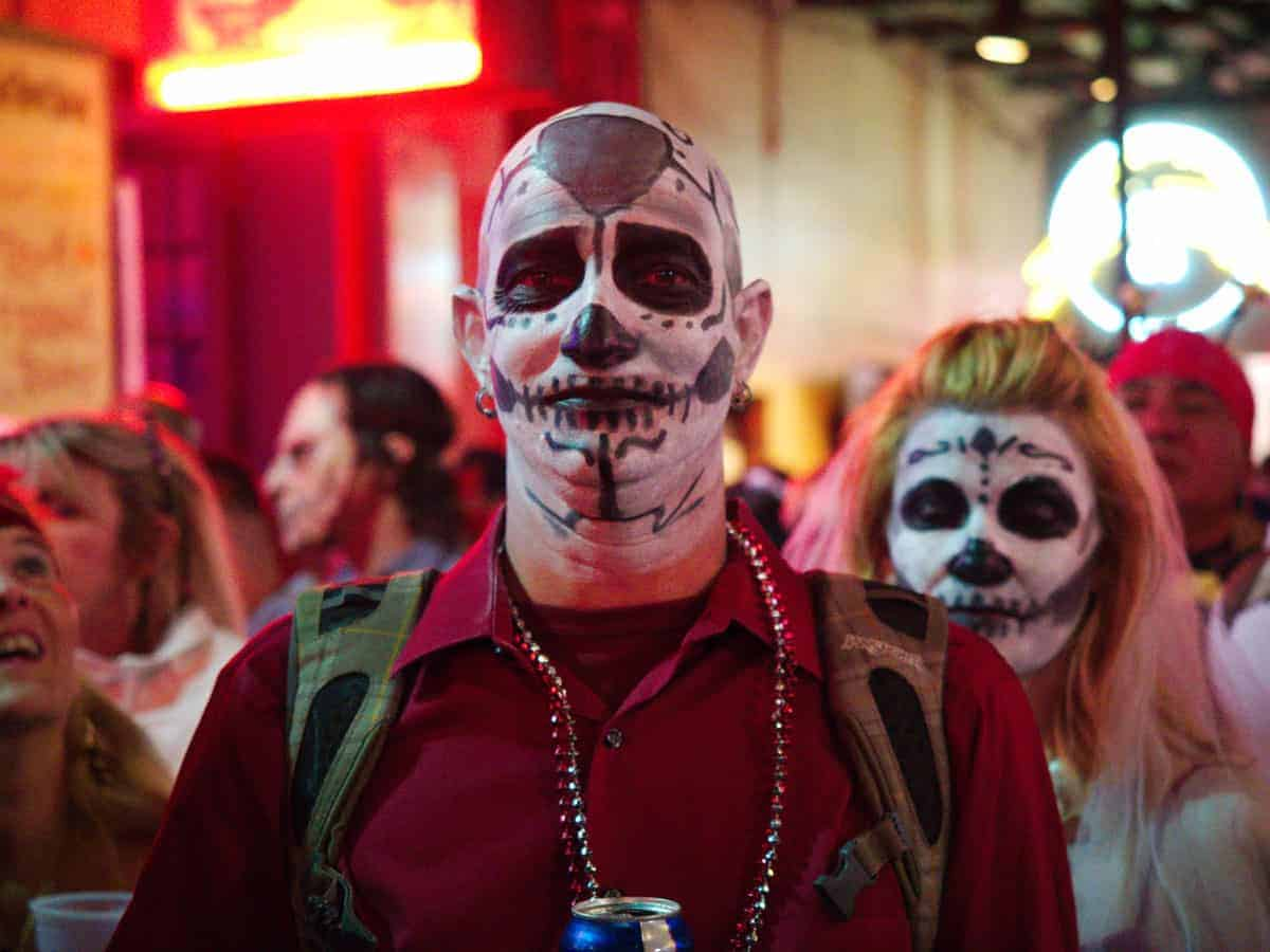 Man with face painted like a skeleton for Halloween celebrations in New Orleans