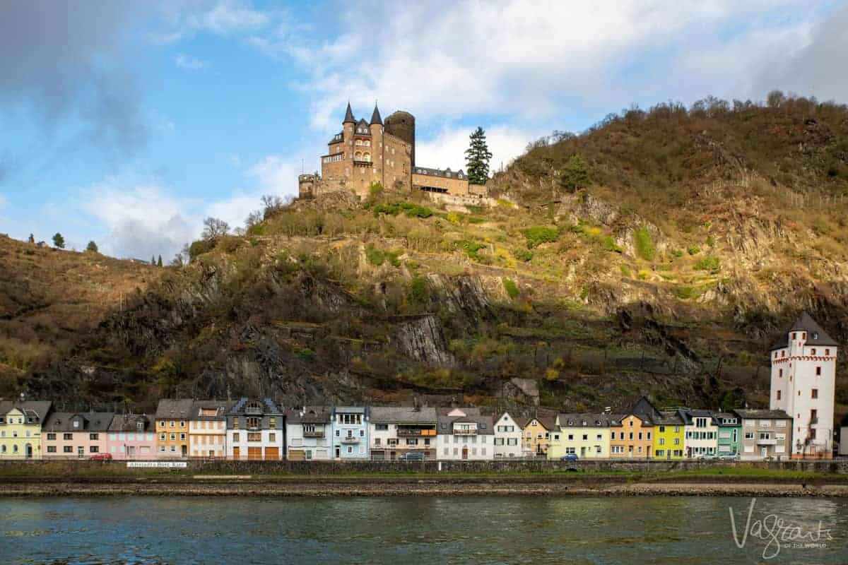 Colourful houses line the Rhine river with a fairytale castle on the hill overlooking the beautiful village and river. This is what you can expect on a Rhine Christmas market cruise.