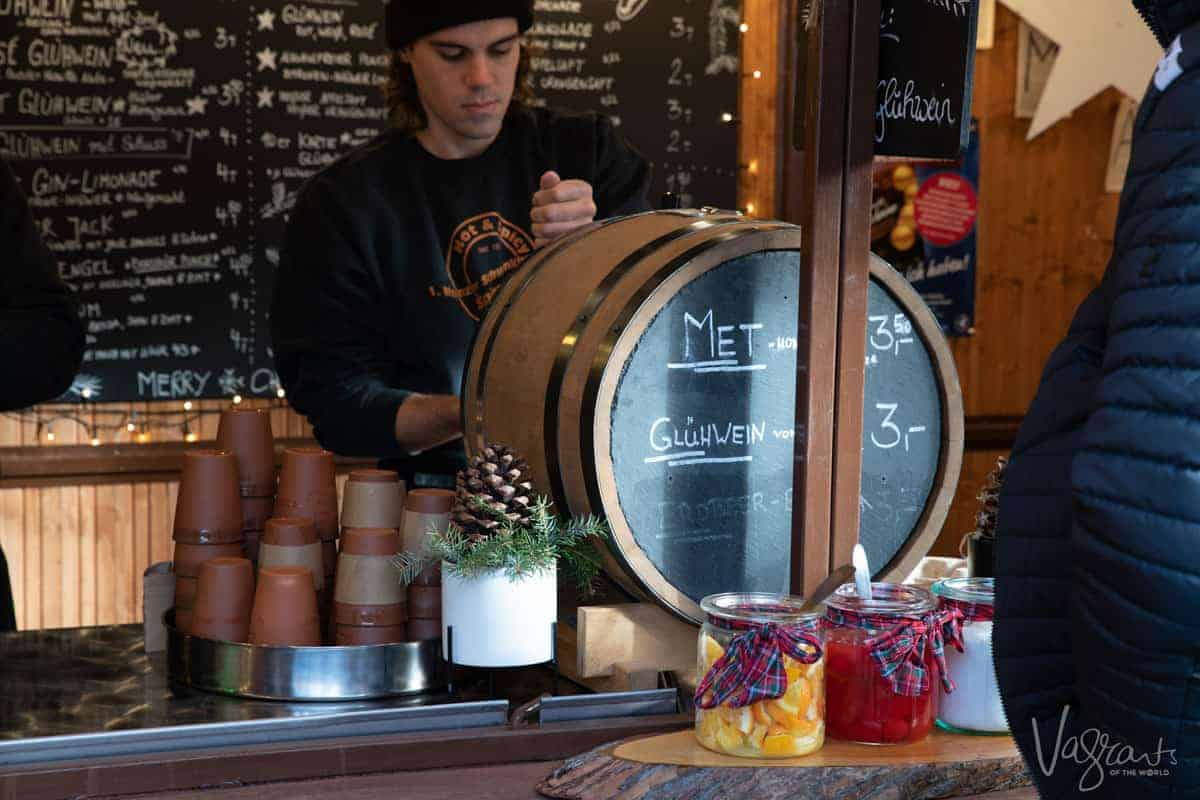 Man pouring Gluhwein from a barrel at a Christmas Market in Germany