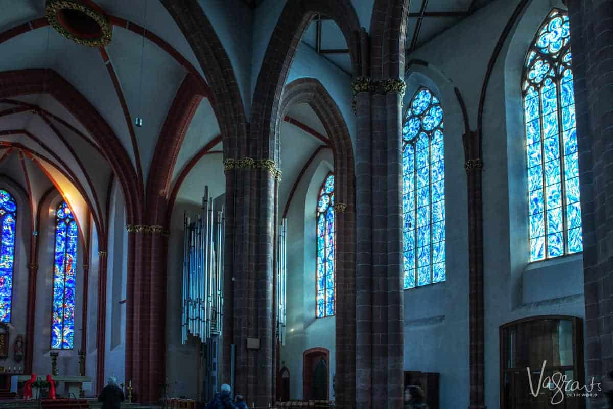 Inside St Stephen's Church in Mainz Germany - Marc Chagall's famous blue stained glass windows. One of the optional shore excursions on a Rhine river cruise from Paris to the Swiss Alps