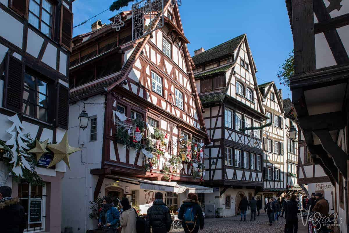 A typical street in Strasbourg old town with medieval wooden buildings on either side.