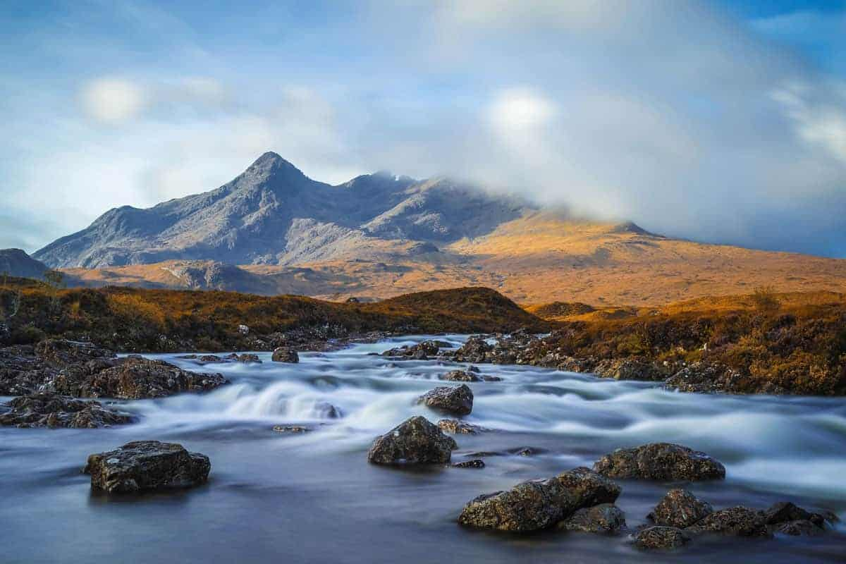 River Sligachan and the mountains of Sgurr nan Gillean on a cloudy day.
