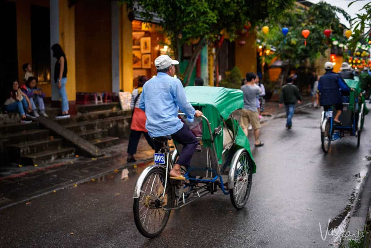 Man riding cyclo cab in Hoi An Old Town