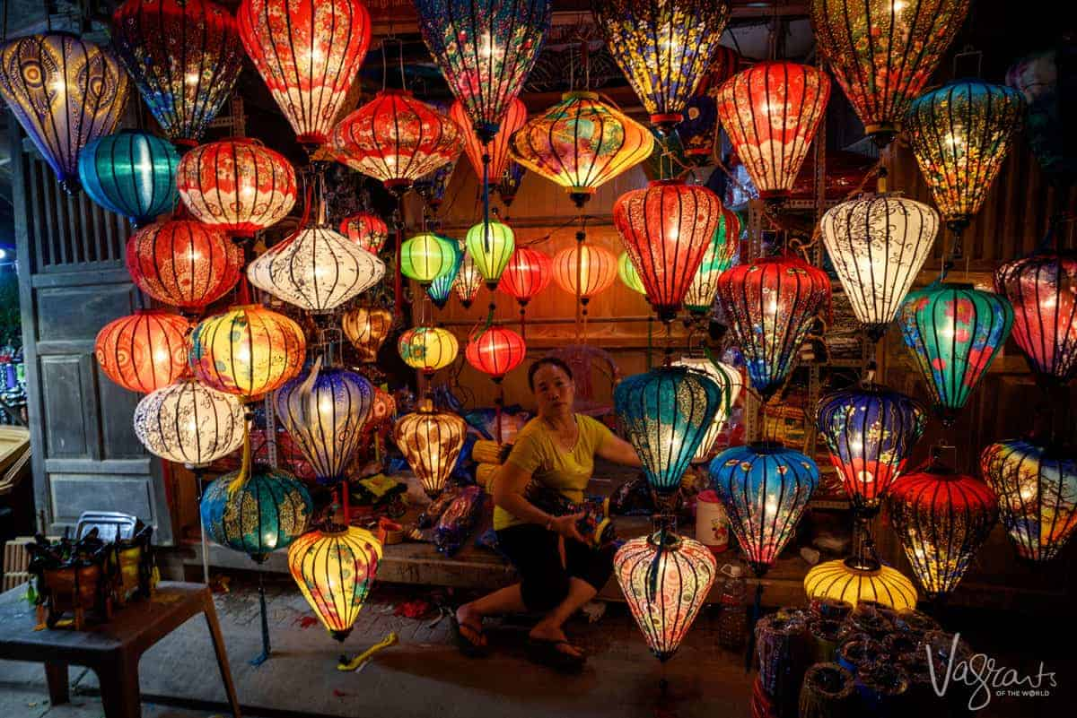 Vietnamese lady sits in a lantern stall in Hoi An Night Market.
