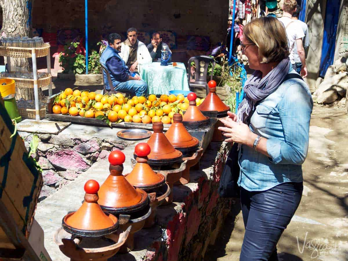 Woman on a day trip from Marrakech to the atlas Mountains choosing a tagine at the markets.