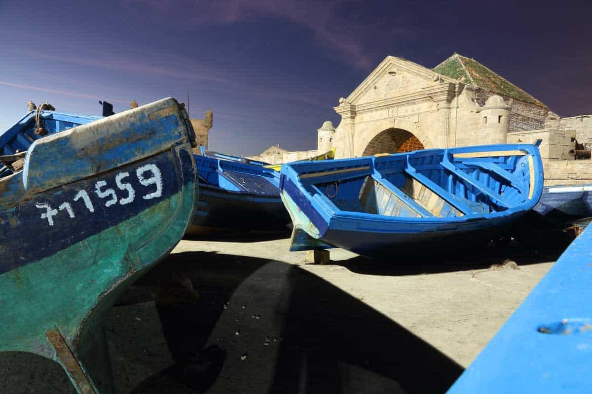 Typical blue fishing boats of Essaouira, a bohemian coastal town in Morocco