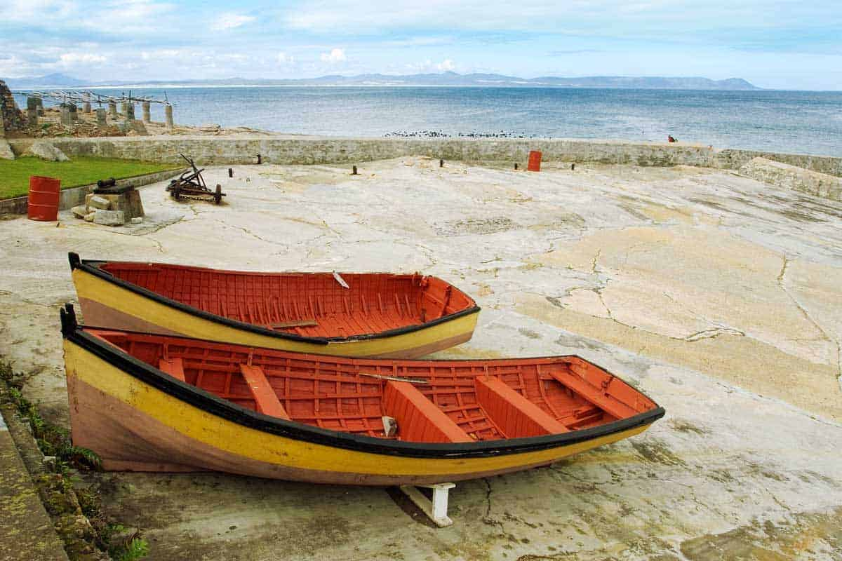 Colourful row boats on the Hermanus Harbour. A popular day trip from Cape Town to see the annual whale migration.