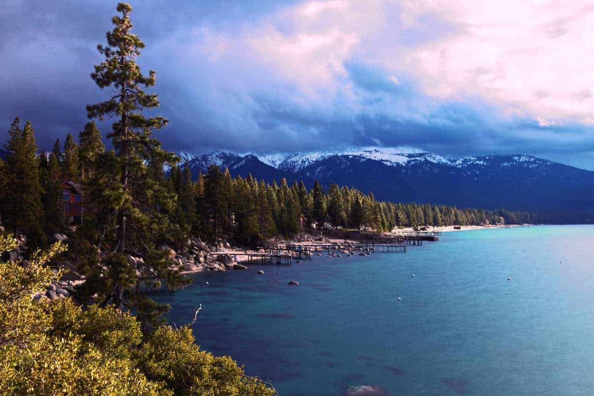 Lake Tahoe, forest and snow capped mountains