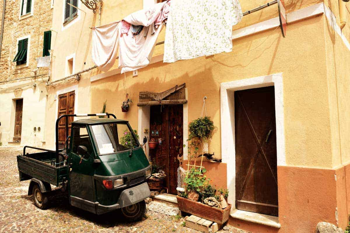 Car hire in Sardinia is the best way to get around and see all the quaint villages with washing hanging out windows and little Ape motorbikes.