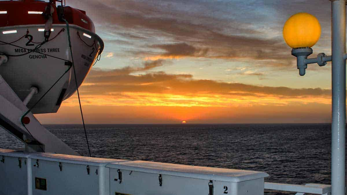 Sunset over the sea from the Sardinia ferryTaking a ferry to Sardinia is a great way to either take your car or enjoy the views of the Mediterranean
