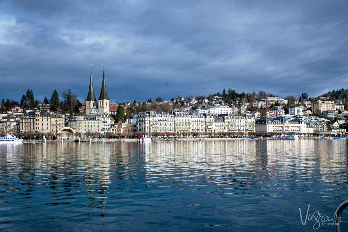 Old town of Lucerne across the lake with the spires of the The Church of St. Leodegar.