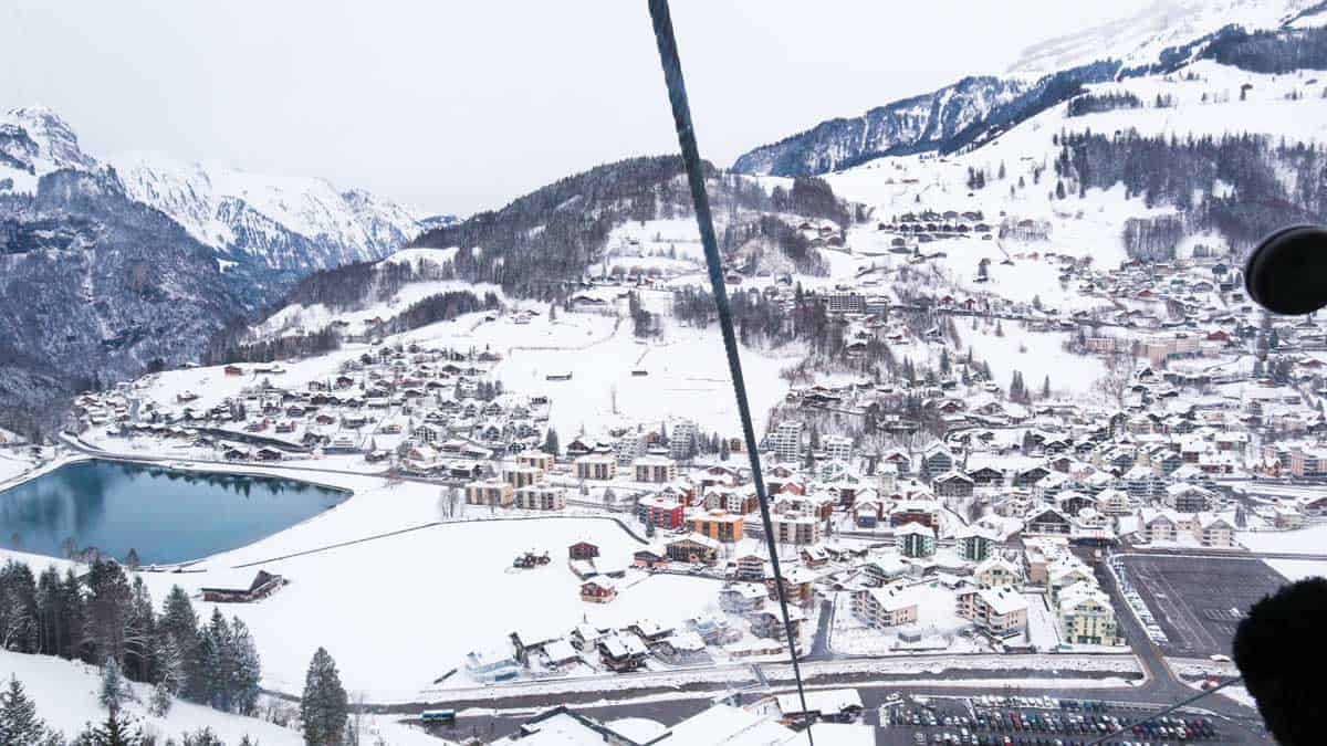 Beautiful snowy views over the mountains from the cable car on the way up to Mount Titlis on a day trip from Lucerne