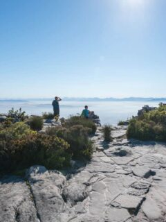 People standing at the top of Table Mountain. One fo the best hikes in Cape Town