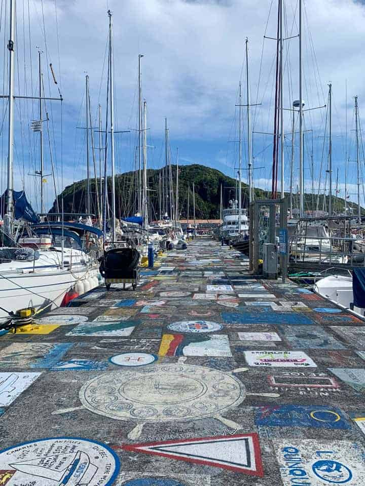 Murals on the docks where the yachts moor on Faial island, Azores.