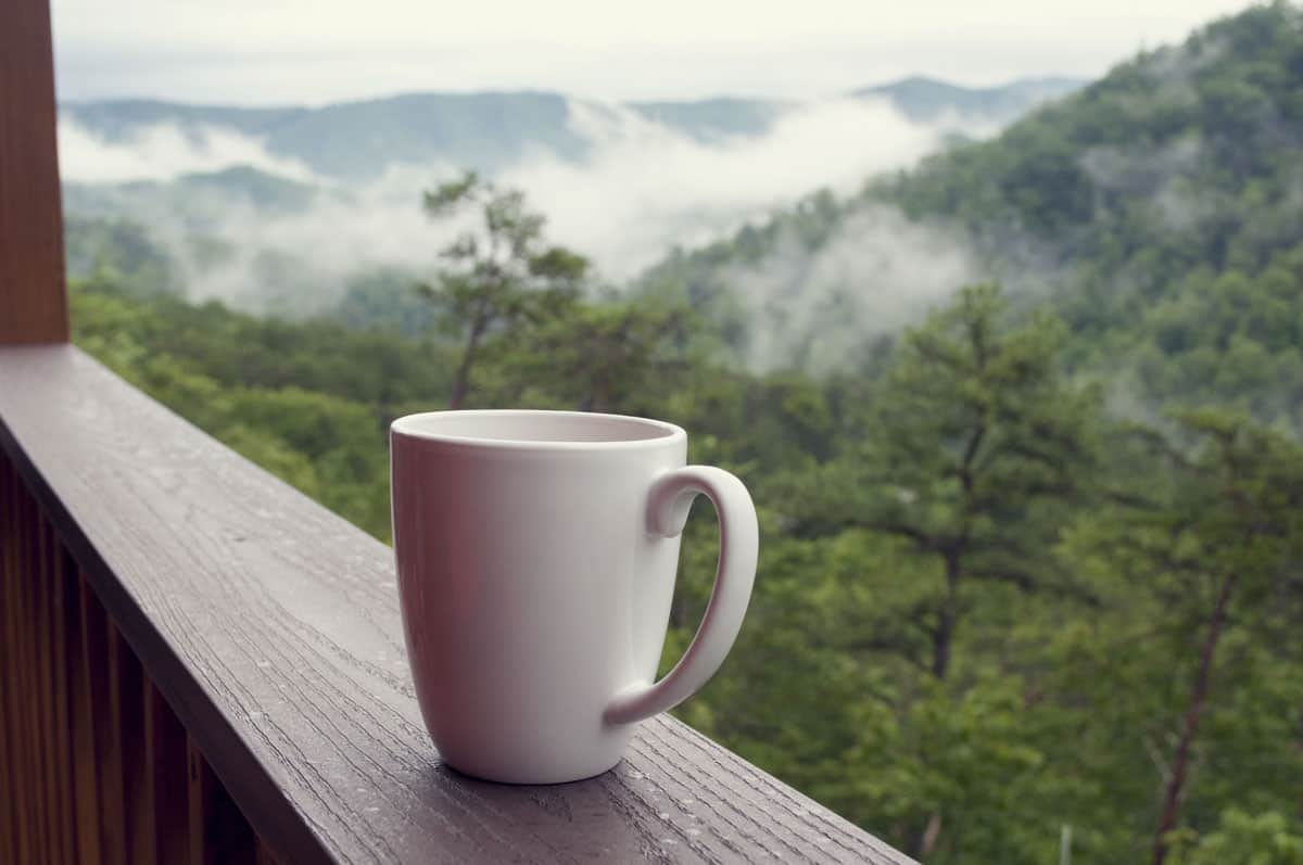 coffee on a mountainside thanks to a portable coffee maker.
