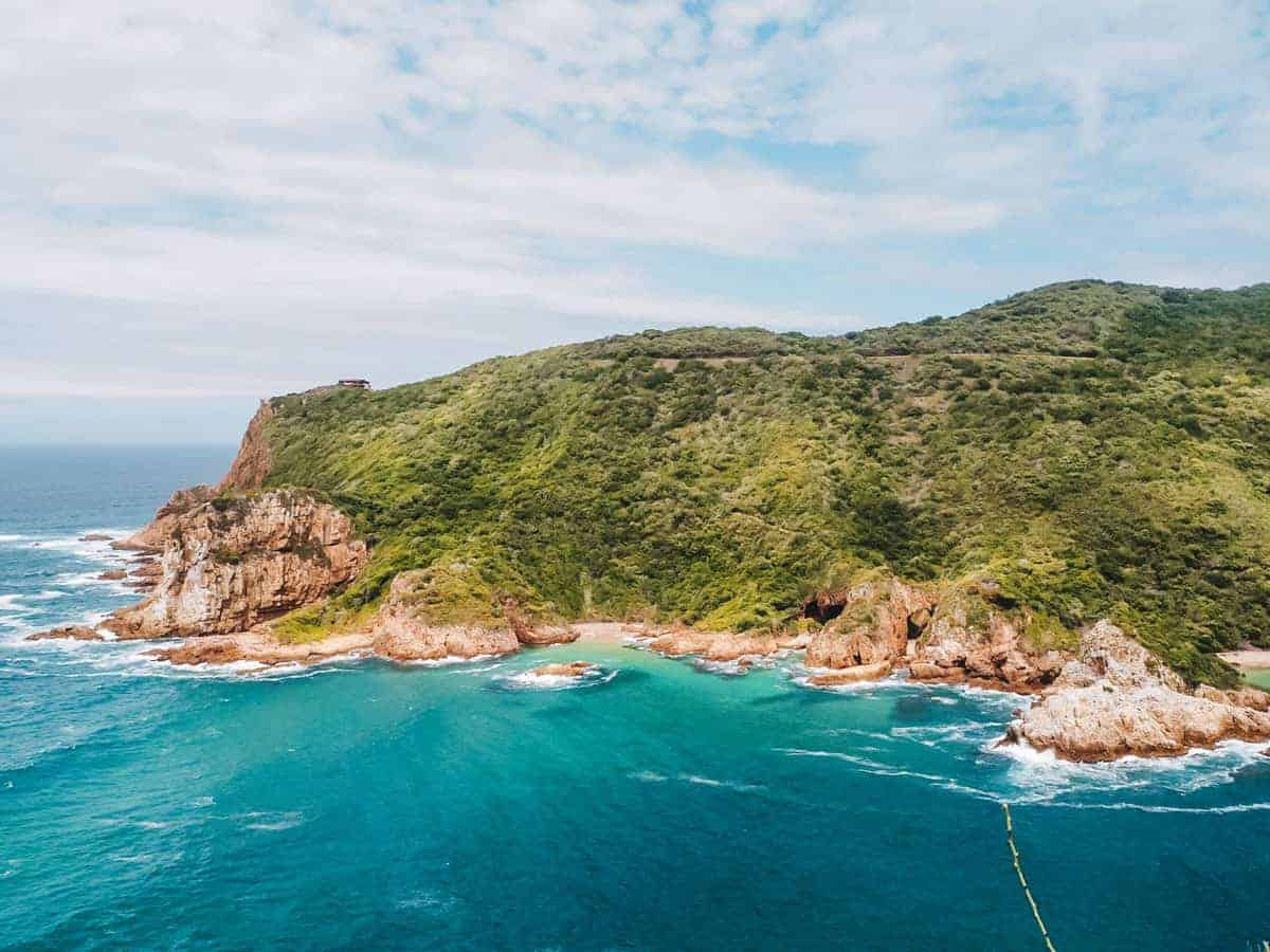 Ocean and the iconic cliffs of Knysna Heads on the Garden Route in South Africa