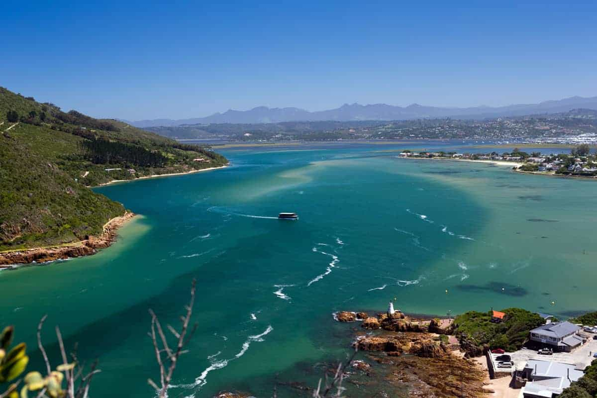 Knysna Lagoon with a single boat on the water. A typical view on the Garden Route in South Africa