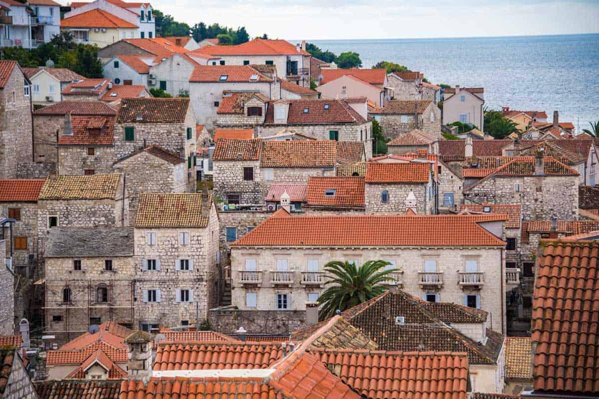 Stone houses and red tiled roofs make Hvar, Croatia.