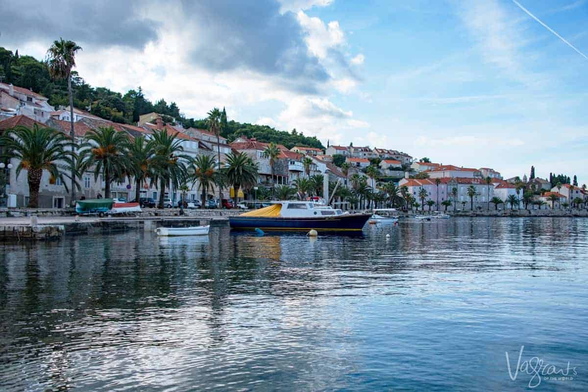 The still waters and palm tree lined waterfront of Korcula island, Croatia.