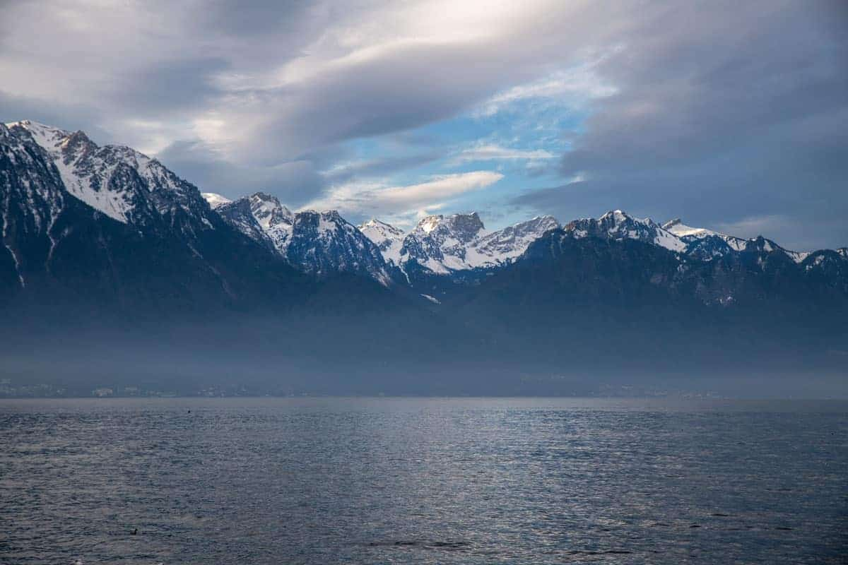 Clouds over the snow capped mountains and lake, Montreux