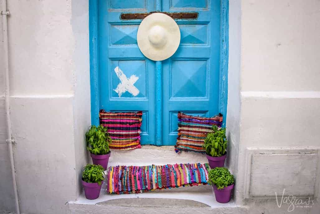 Blue doors and colourful cushions, mat and hat, welcome to Chora Old town,Mykonos.