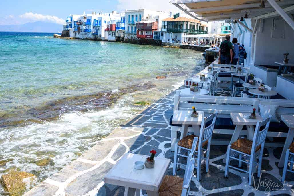 Water lapping the stone deck of outdoor restaurant in Little Venice, Mykonos.