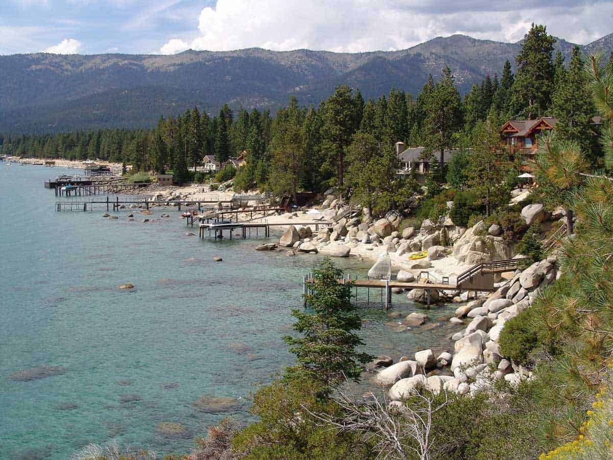 Rocky shoreline and wooden jetties of Kings Beach, North Lake Tahoe