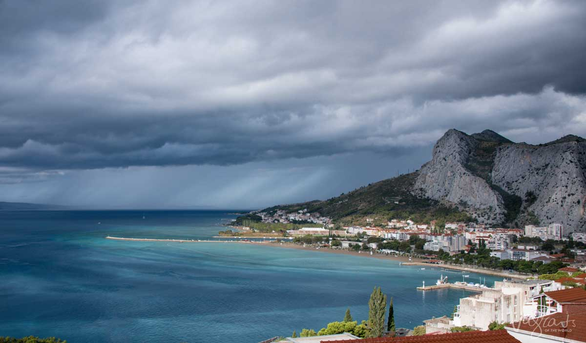 Pirate town of Omis under a dark and stormy sky.