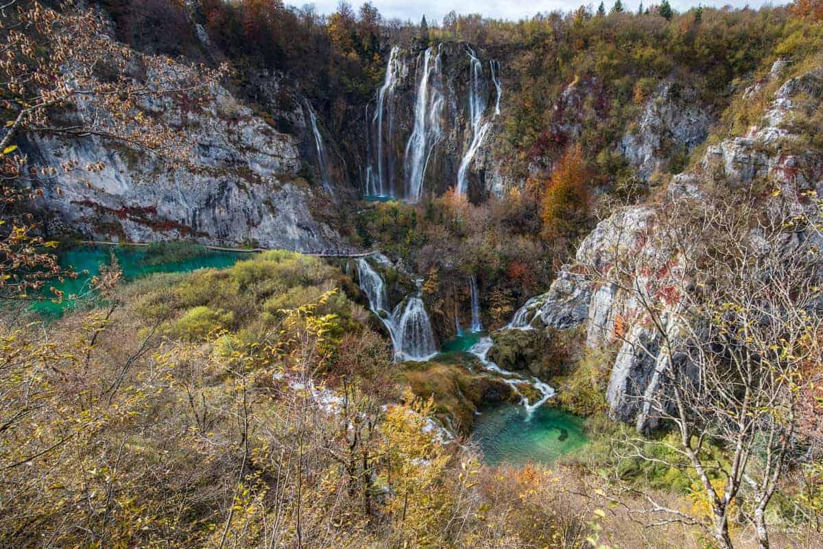 Cascading waterfalls and fall foliage at Plitvice Lakes, Croatia.