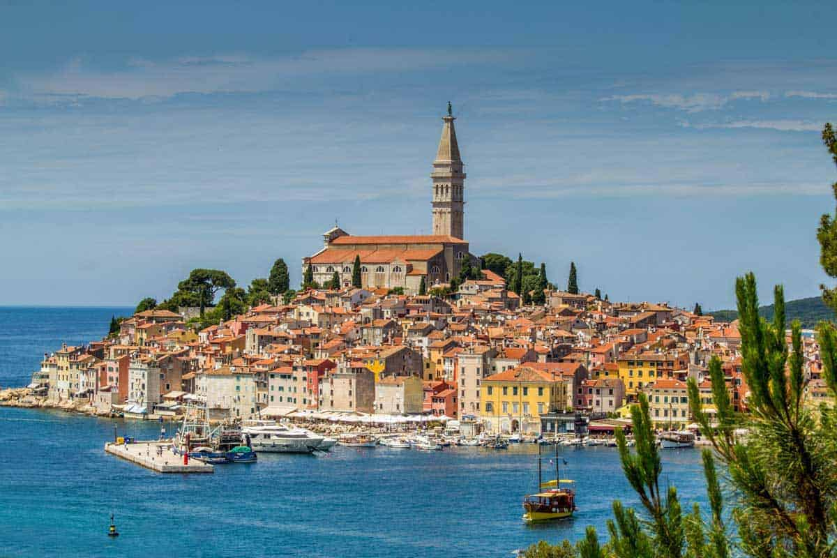 Bustling harbour and old town of Rovinj, Croatia.