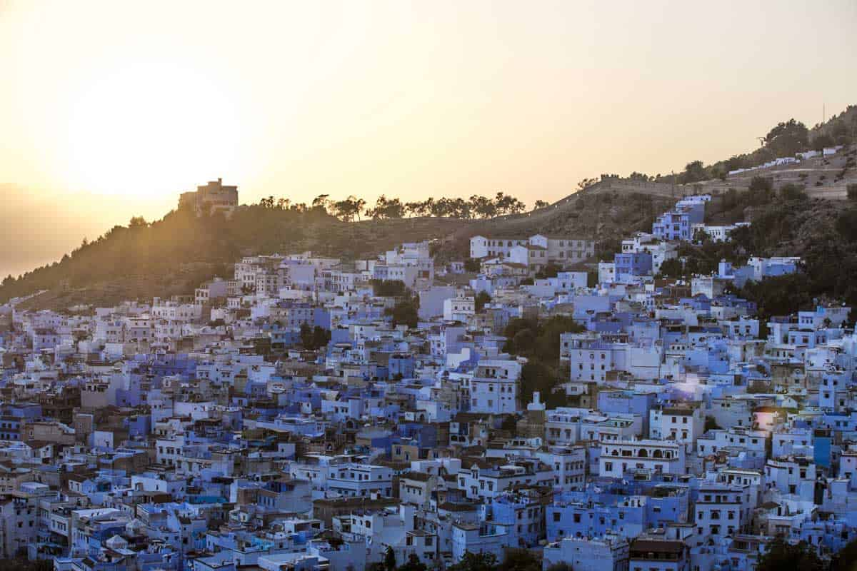 Blue and white city of Chefchaouen at sunset.